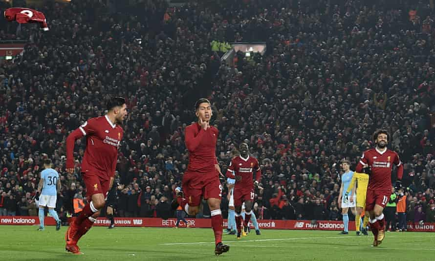 Roberto Firmino (centre) celebrates after scoring Liverpool's second goal in January 2018.