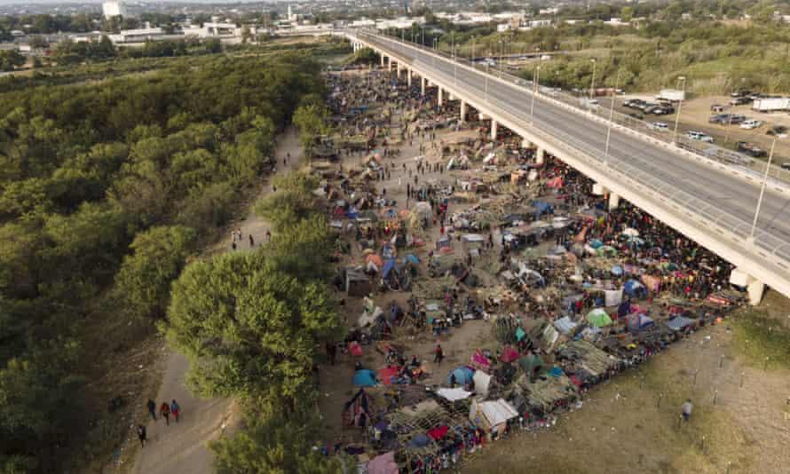 Migrants, many from Haiti, are seen at an encampment along the Del Rio international bridge near the Rio Grande, on Tuesday.
