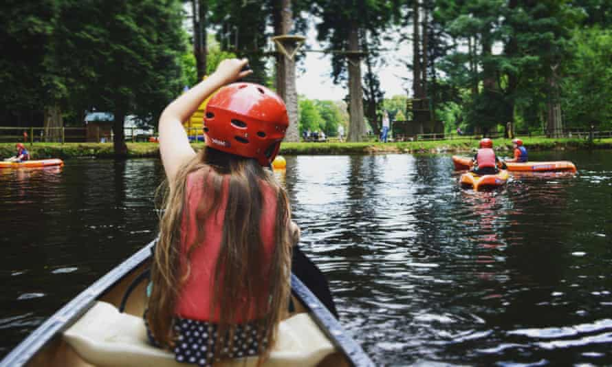 Canoeing on the lake at River Dart country park, Devon.