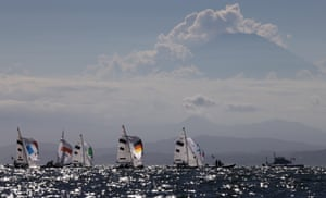 Competitors in action at the women's 470 sailing medal race at Enoshima Yacht Harbour.