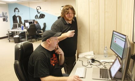 Garland Couch (seated) works on some code with James Johnson (standing)
