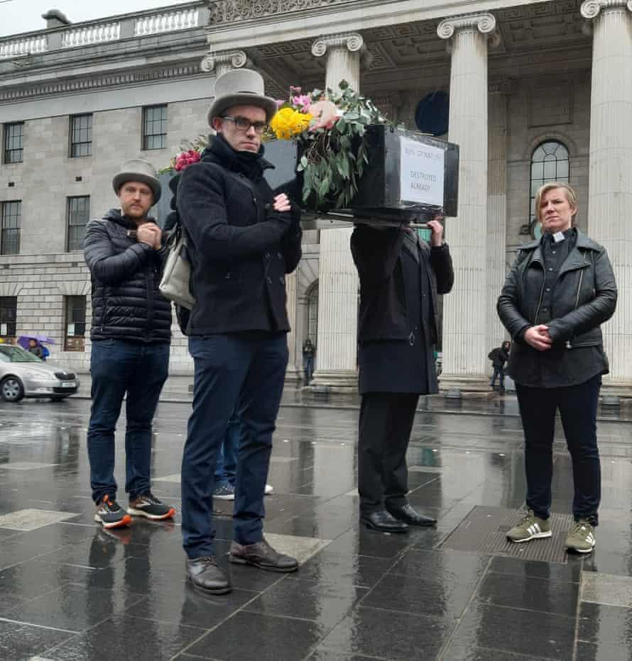 Extinction Rebellion Ireland activists carry a coffin through Dublin on 3 March 2019 to mark World Wildlife Day