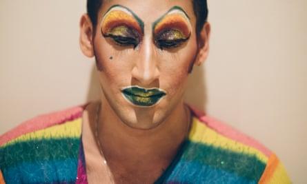 Amrou Al-Kadhi's face, looking down, in full drag makeup