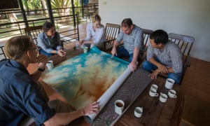 The team at Siem Reap's École Française d'Extrême-Orient look at a map of the site.