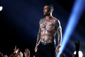 Adam Levine of Maroon 5 strips off at the Super Bowl.