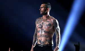 Adam Levine strips off at the Super Bowl.