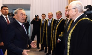 Nursultan Nazarbayev and Lord Faulks, second from right.