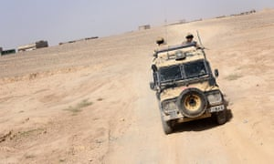 Soldiers patrol in a Snatch Land Rover in Helmand, Afghanistan, in 2006