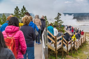 A crowded boardwalk in the Lower Geyser Basin in Yellowstone.