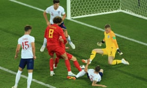 Jordan Pickford slides off his line as Marouane Fellaini threatens the England goal.