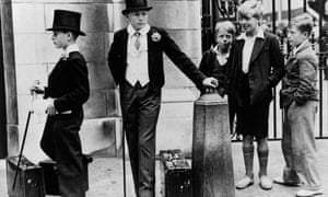 Boys in top hats watched by less well-off boys