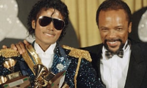 Michael Jackson poses with Quincy Jones at the 1984 Grammy Awards in Los Angeles.