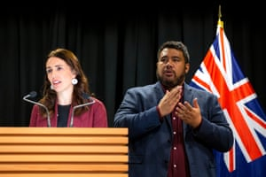 Alan Wendt signs while Prime Minister Jacinda Ardern speaks during a post cabinet press conference at Parliament on June 4, 2019 in Wellington, New Zealand.