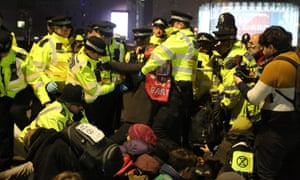 Police begin to arrest protesters on Waterloo Bridge.