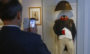 A visitor takes pictures of Napoleon's clothes