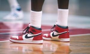 Michael Jordan wearing Air Jordan Nike trainers on the basketball court, 1985
