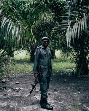 A local police man in Ughelli, Niger Delta, Nigeria.
