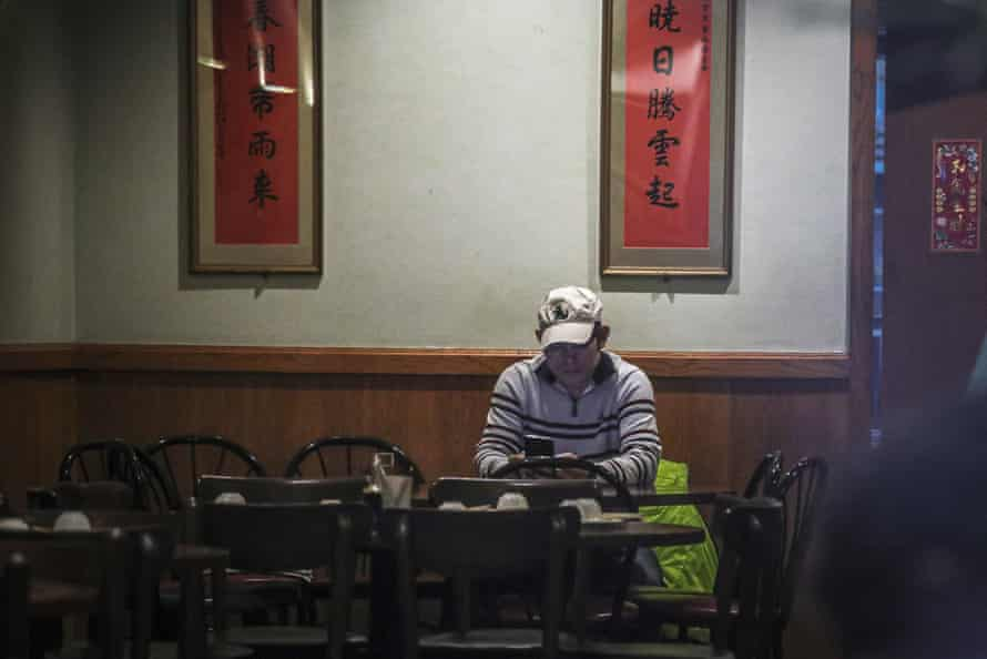Frankie Chu, owner of Vegetarian Dim Sum House in Chinatown, sits in his empty restaurant on 13 February.