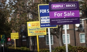 Estate agents' boards advertising homes for sale