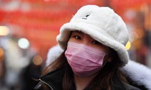 A woman wears a face mask in London