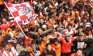 Jakmania fans protest following violent clashes with the police.