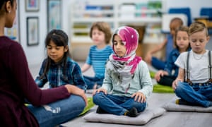 ▲ The Mental Health Foundation wants emotional wellbeing to sit at the heart of school curriculum photography: gettyA multi-ethnic group of young school children are indoors in their classroom. They are sitting on pillows and doing yoga together. They are sitting with their hands in their lap.
