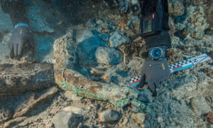 The bronze arm on the seafloor during the excavation.