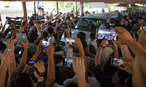 Crowds take pictures of Aung San Suu Kyi as she arrives at a polling station in Yangon on Sunday.