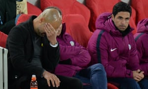 Pep Guardiola and a disconsolate Manchester City bench during the 3-0 defeat at Liverpool
