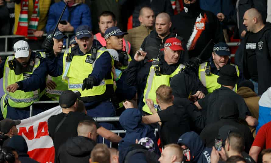 Police move into the away end at Wembley.