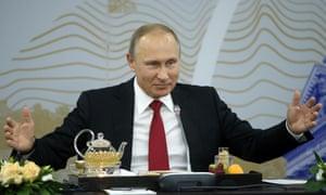 Vladimir Putin at a summit it St Petersburg.
