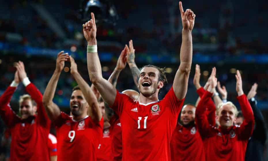 Gareth Bale (centre) and Wales celebrate their 3-1 quarter-final victory against Belgium at Euro 2016.