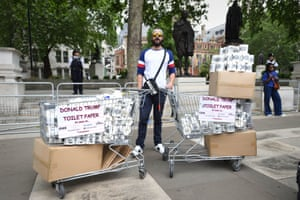 A man sells 'Donald Trump toilet paper' during protests in Parliament Square