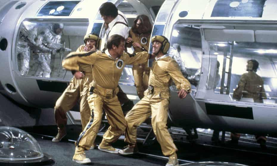 Roger Moore as James Bond socks it to some foes in Moonraker.