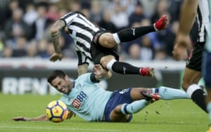 Bournemouth's Andrew Surman slides in on Newcastle's Joseluas The Cherries see out a 1-0 win at St James' Park.