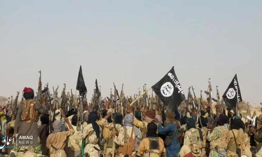 Islamic State fighters celebrate in May 2019 after an ambush on an army patrol, in the western Tillabéri region of Niger, that killed at least 28 troops.