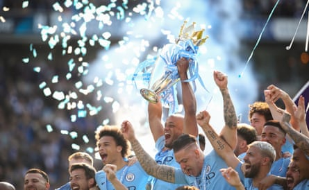 Vincent Kompany of Manchester City lifts the English Premier League Trophy as they celebrate becoming champions after beating Brighton & Hove Albion on May 12, 2019