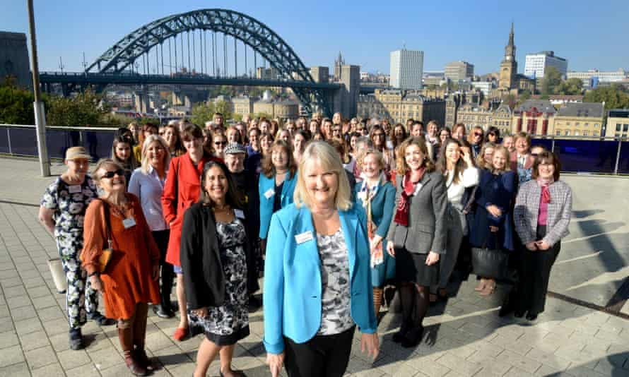 Penny Marshall (front, centre, in turquise jacket) in front of the Tyne Bridge on the Women in Engineering Day 2018, when 90 women engineers were brought together to celebrate the 90th anniversary of the Tyne bridge opening, and recognise the involvement of Dorothy Donaldson Buchanan – first female member of the institution of Civil Engineers, who worked on the project.