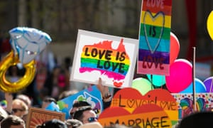 love is love signs at a same-sex marriage march