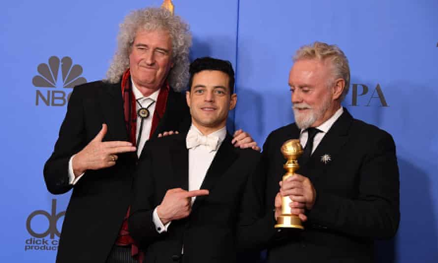 Rami Malek, centre, the winner of best actor for his portrayal of Freddie Mercury, poses with Queen band members Brian May and Roger Taylor.