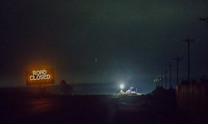 Lights are seen from the Narrows roadblock near Burns, Oregon, as FBI agents surrounded the remaining four occupiers at the Malheur national wildlife refuge.