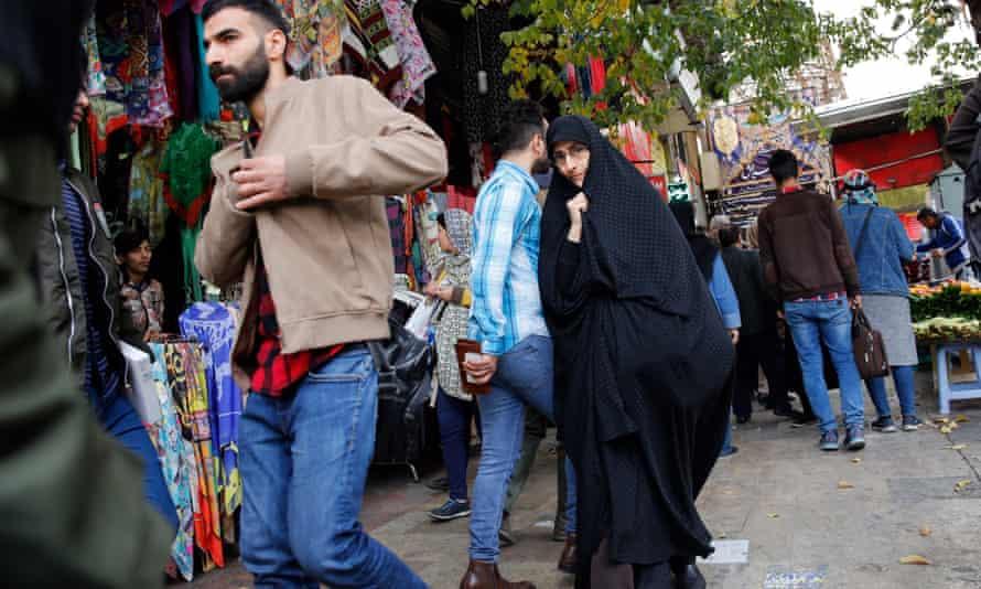 Iranians shop in a bazaar in Tehran, Iran.