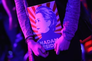 A guest clutches a magazine showing a stylized Hillary Clinton and that reads: Madam President at the Democrats Abroad US election party