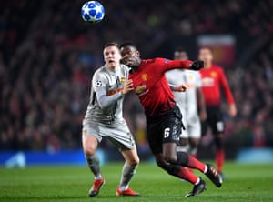 Paul Pogba of Manchester United battles with Michel Aebischer of Young Boys.
