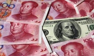 A U.S. $100 banknote placed next to 100 yuan banknotes in Beijing.