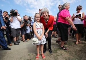 Llanewedd, UK. Theresa May poses for a photo with Anest Jones, 6, from the Brecon Beacons, during a visit to the Royal Welsh show. The prime minister has confirmed that the government is making preparations in case of a no-deal Brexit.