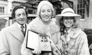 Vera Lynn with her husband Harry Lewis and daughter Virginia Lewis outside Buckingham Palace after being made Dame Commander Of The Order Of The British Empire on 12 December 1975