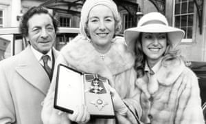 Vera Lynn with her husband, Harry Lewis, and daughter, now Virginia Lewis-Jones, after being made a dame in 1975.