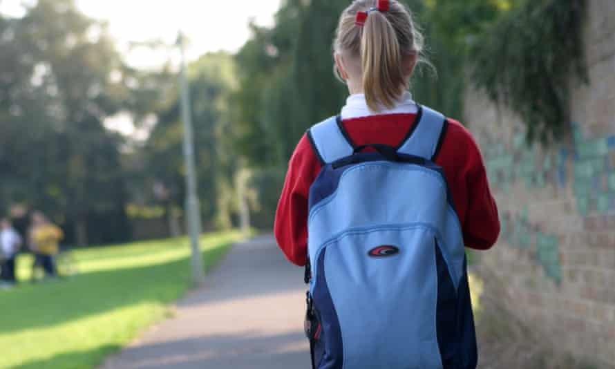 A girl on her way home from school.