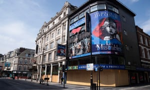 A closed theatre in London's West End, with Les Miserables posters